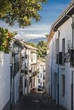 The narrow street with old houses, Granada, Spain.