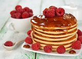 Pancakes with caramel sauce and raspberries
