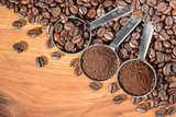 coffee beans and powder in the spoon, top view