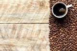 coffee beans on wooden with coffe cup table top view