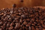Coffee beans on table on brown background