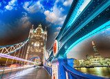 Night over Tower Bridge in London. Blue shapes of metal structur