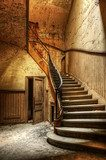 Decaying staircase in an abandoned central office