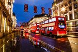 Red Bus on the Rainy Street of London in the Night, United Kingd
