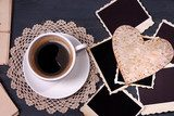 Composition with coffee cup, letters and old blank photos,