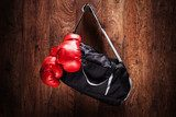 Sports bag and boxing gloves hanging on a wall