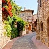 Flower lined street in the town of Assisi, Italy