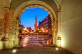 Green gate view for city hall of Gdansk at night, Poland