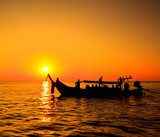 Boat in the sunset near Koh Phi Phi of Thailand