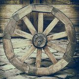 Vintage stylized photo of wooden cart wheel