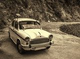 Vintage style photo of retro car parked at nature