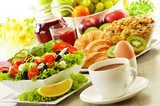 Breakfast with coffee, juice, croissant, salad, musli and egg