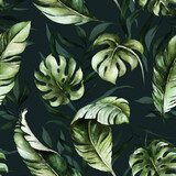 Green tropical leaves on dark background. Watercolor hand painted seamless pattern. Floral tropic illustration. Jungle foliage.