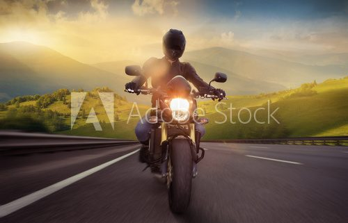 Man seat on the motorcycle on the mountain road