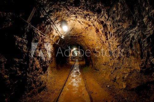 Underground mine passage with rails