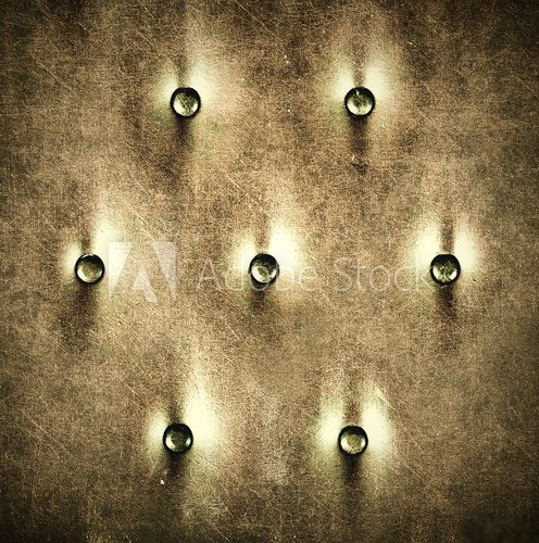Luxury and grungy background of leather with metal buttons