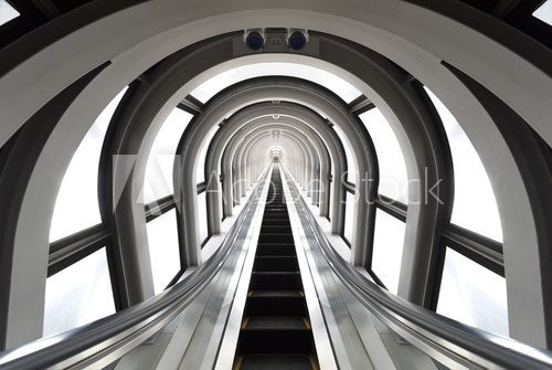 Futuristic tunnel and escalator of steel and metal, interior view. Futuristic background, business concept